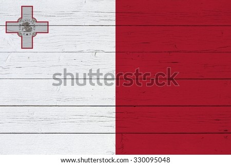 Flag of Malta on wooden background