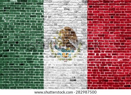Flag of Mexico painted on brick wall, background texture - stock photo