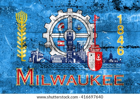 Flag of Milwaukee, Wisconsin, painted on dirty wall. Vintage and old look.
