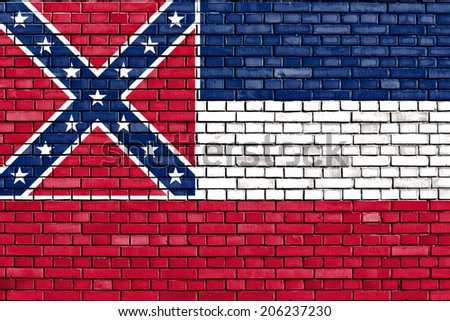 flag of Mississippi painted on brick wall - stock photo