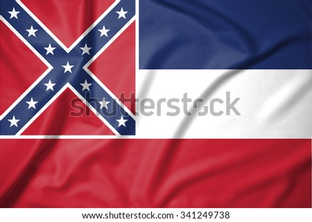 Flag of Mississippi state of United States of America on soft and smooth silk texture - stock photo