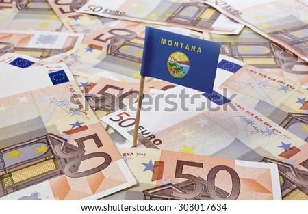 Flag of Montana sticking in european banknotes.(series) - stock photo
