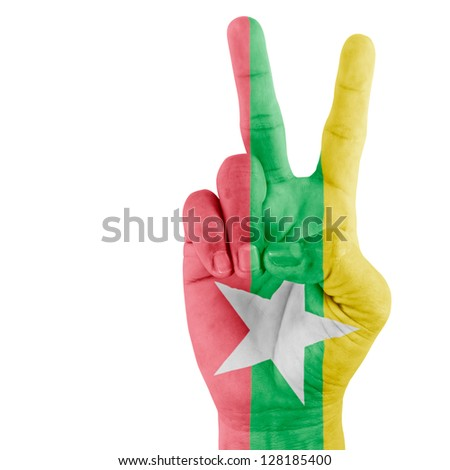 Flag Of Myanma on victory hand with a white background. - stock photo