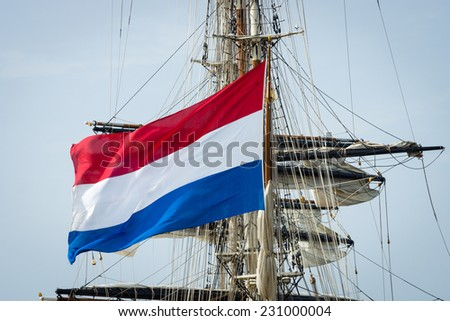 Flag of Netherlands against the background of the rigging of sailing ship. - stock photo
