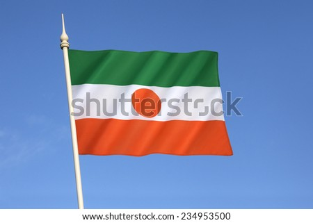 Flag of Niger - the national symbol of the West African Republic of Niger since 1959, a year prior to its formal independence from France. - stock photo
