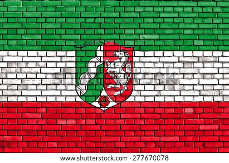flag of North Rhine-Westphalia painted on brick wall - stock photo