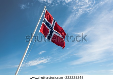 Flag of Norway on the blue sky background. - stock photo