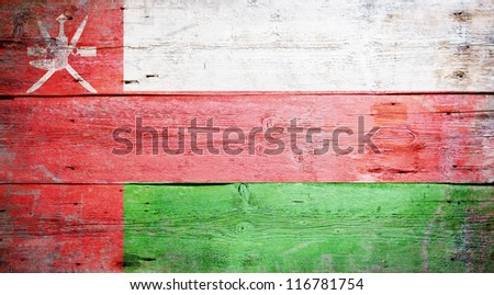 Flag of Oman painted on grungy wood plank background - stock photo