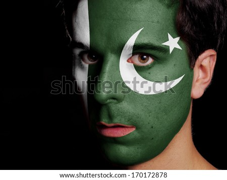 Flag of Pakistan Painted on a Face of a Young Man - stock photo