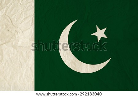 Flag of Pakistan with vintage old paper texture - Flag of the Crescent and Star - stock photo