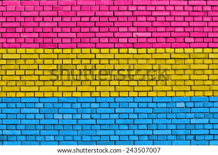 flag of Pansexual Pride painted on brick wall