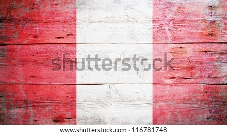 Flag of Peru painted on grungy wood plank background - stock photo
