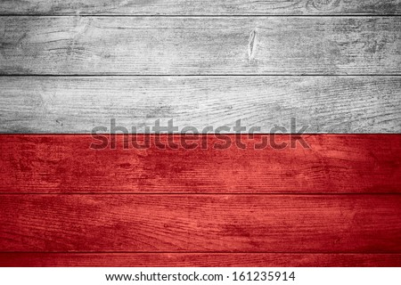 flag of Poland or Polish banner on wooden background - stock photo