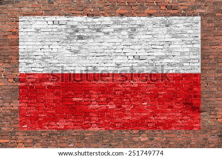 Flag of Poland painted on aged brick wall