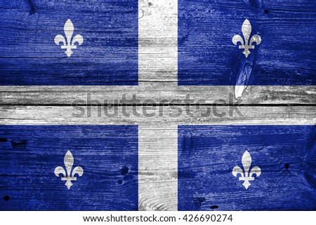 Flag of Quebec, painted on old wood plank background - stock photo