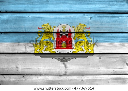 Flag of Riga, Latvia, painted on old wood plank background