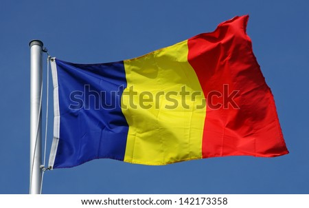 Flag of Romania on a sunny day - stock photo