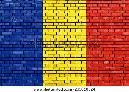 flag of Romania painted on brick wall