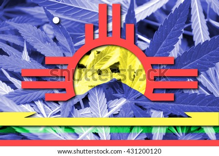 Flag of Roswell, New Mexico, on cannabis background. Drug policy. Legalization of marijuana - stock photo