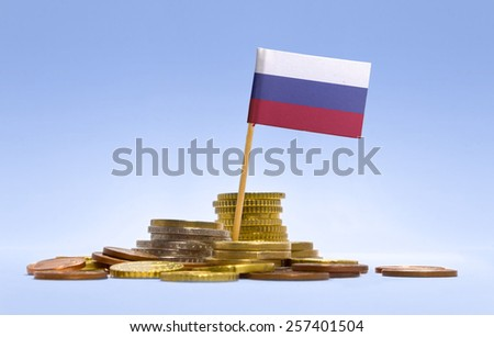 Flag of Russia in a mixed stack of european coins and a blue background.(series) - stock photo