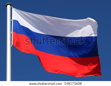 Flag of Russia in the sun - stock photo