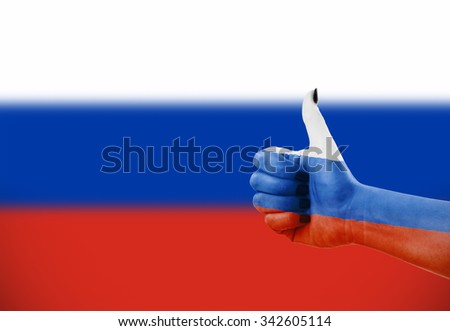 Flag of Russia on female's hand, defocused flag in background - stock photo