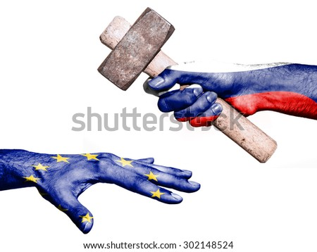 Flag of Russia overprinted on a hand holding a heavy hammer hitting a hand representing the European Union. Conceptual image for political, fiscal or social aggressions, penalties, taxation - stock photo