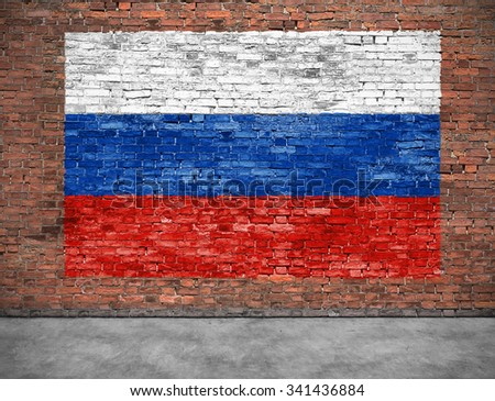 Flag of Russsia on brick wall with small part of foreground - stock photo