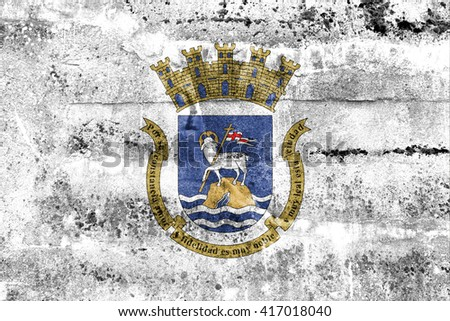 Flag of San Juan, Puerto Rico, painted on dirty wall. Vintage and old look. - stock photo