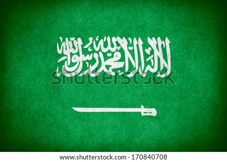 flag of Saudi Arabia or Saudi Arabian national banner on paper rough pattern texture - stock photo