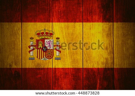 flag of Spain or Spanish banner on wooden background