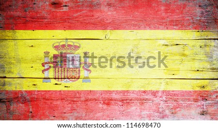 Flag of Spain painted on grungy wood plank background