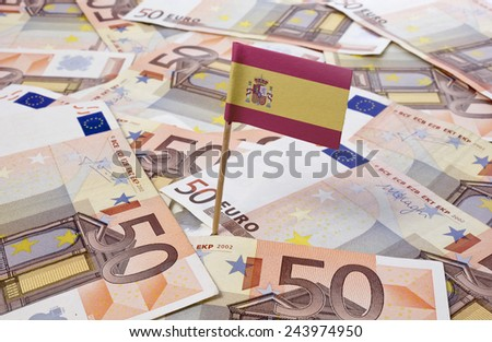 Flag of Spain sticking in european banknotes.(series) - stock photo