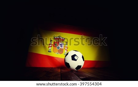 Flag of Spain with football on wooden boards as the background. Vintage Style. MANY OTHER PHOTOS FROM THIS SERIES IN MY PORTFOLIO. - stock photo