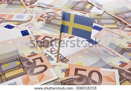Flag of Sweden sticking in european banknotes.(series) - stock photo
