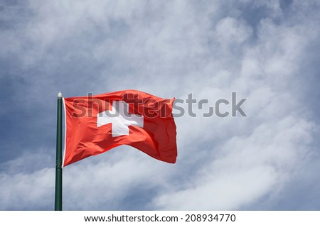 Flag of Switzerland on a sky - stock photo