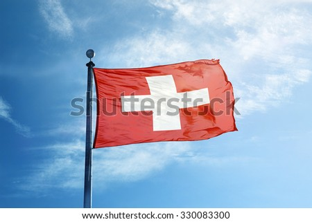 Flag of Switzerland on the mast - stock photo