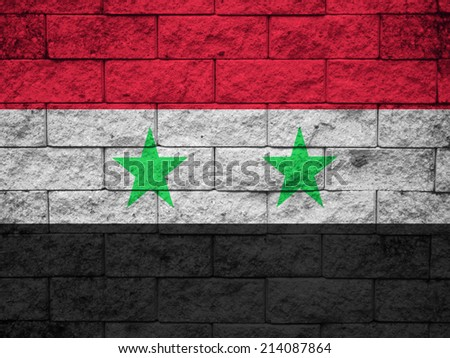 Flag of Syria painted onto a grunge brick wall  - stock photo