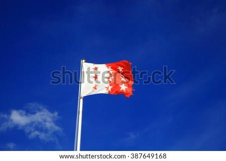 Flag of the canton Valais, Switzerland  - stock photo