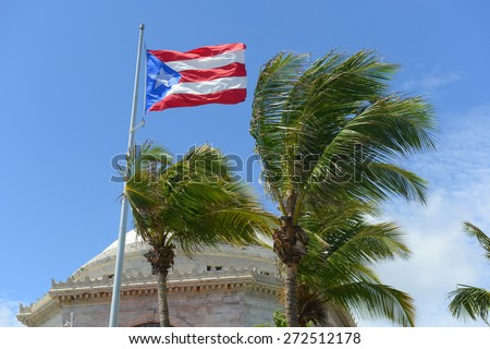 Flag of the Commonwealth of Puerto Rico in front of Capitolio, San Juan, Puerto Rico. - stock photo
