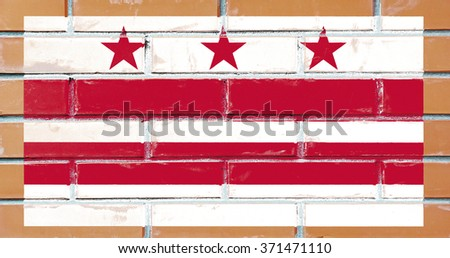 Flag of the district of Colombia (USA) on a brick wall - stock photo