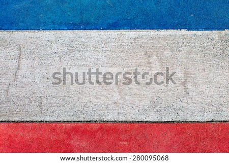 Flag of the Kingdom of Yugoslavia painted onto a grunge cement wall - stock photo