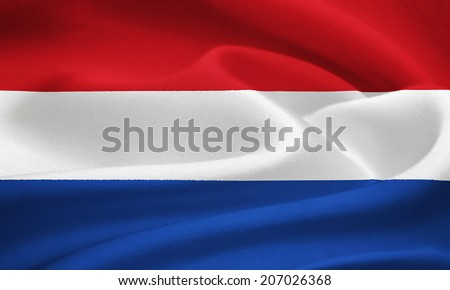 Flag of the Netherlands waving in the wind. Silk texture pattern - stock photo