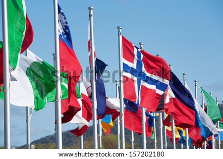 Flag of the Norway flapping in the wind amongst other national flags