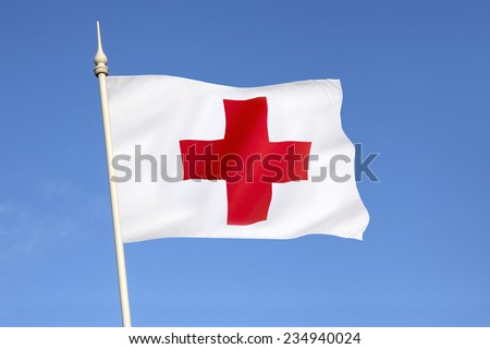 Flag of the Red Cross - the International Movement of the Red Cross and the Red Crescent, are international humanitarian organizations bringing relief to victims of war or natural disaster.  - stock photo
