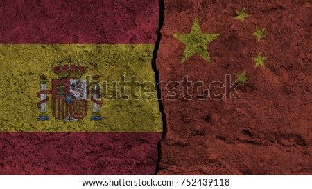 Flag of the spain and China painted on wall divided with crack ,conflict - relations concept