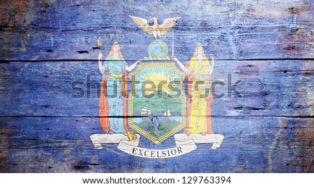Flag of the State of New York painted on grungy wooden background - stock photo