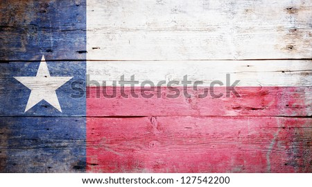 Flag of the State of Texas painted on grungy wooden background - stock photo