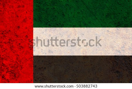 Flag of the United Arab Emirates on rusty metal
