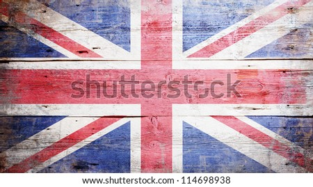 Flag of the United Kingdom painted on grungy wood plank background